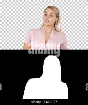 Young woman talking to the camera, Alpha Channel - Stock Photo