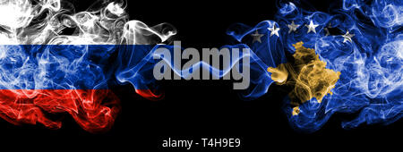 Russian vs Kosovo, Serbia smoke flags placed side by side. Thick colored silky smoke flags of Russia and Kosovo, Serbia - Stock Photo