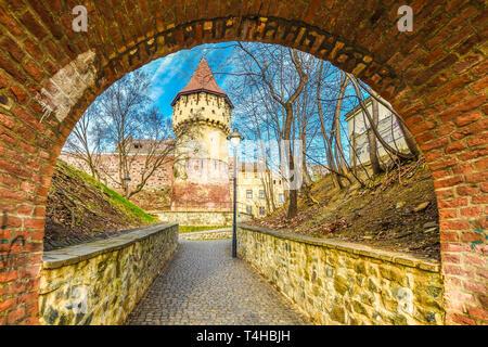 Medieval defense wall and The Carpenters' Tower in Sibiu city, Transylvania region, Romania. - Stock Photo