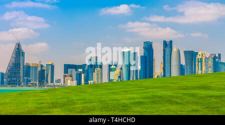 The Capital city of Qatar and Doha Bay from West Mound-Skyline viewpoint. Doha, Persian Gulf, Middle East, Arabian Peninsula. Sunny day. Urban scenary - Stock Photo