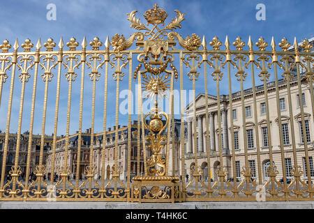Golden fence in exterior facade of Versailles Palace, Paris, France - Stock Photo