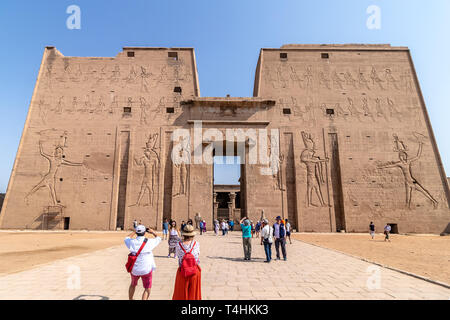 Aswan, Egypt - September 13, 2018: Tourists visiting the Edfu Temple. Dedicated to the Falcon God Horus, Located on the west bank of the Nile, Edfu, U Stock Photo