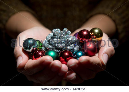 ornaments in open palms - Stock Photo