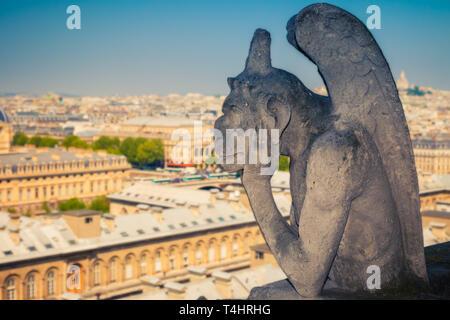 Gargoyle on Notre Dame Cathedral, Paris - Stock Photo