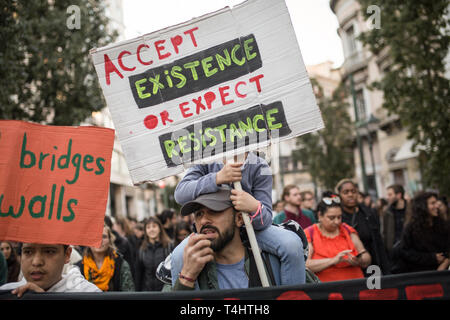 Athen, Greece. 16th Apr, 2019. A child holds a sign with the inscription: 'Accept the existence or expect the resistance' during a demonstration organized by members of anti-racist organizations and trade unions against refugee expulsions. Credit: Socrates Baltagiannis/dpa/Alamy Live News - Stock Photo