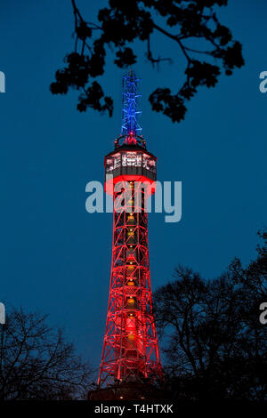 Prague, Czech Republic. 16th Apr, 2019. The lookout tower on Petrin hill in Prague centre was lit in the French national colours, red, blue and white, today, on Tuesday, April 20, 2019, in memory of the yesterday's fire-damaged Notre-Dame Cathedral in Paris. Credit: Vit Simanek/CTK Photo/Alamy Live News - Stock Photo
