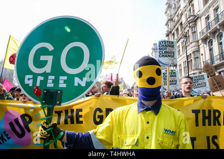 London, UK. 15th Apr, 2019. An environmental activist seen holding a placard that says go green during the demonstration at the Parliament Square. Activist protest at the Parliament Square demanding for urgent Government action on climate change, the protest was organised by 'Extinction Rebellion.' Credit: Dinendra Haria/SOPA Images/ZUMA Wire/Alamy Live News - Stock Photo