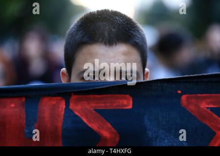 Athens, Greece. 16th Apr, 2019. A protestor attends a demonstration against the Greek government's decision to demand refugees leave the apartments in which they have been living for newcomers in Athens, Greece, on April 16, 2019. Credit: Marios Lolos/Xinhua/Alamy Live News - Stock Photo