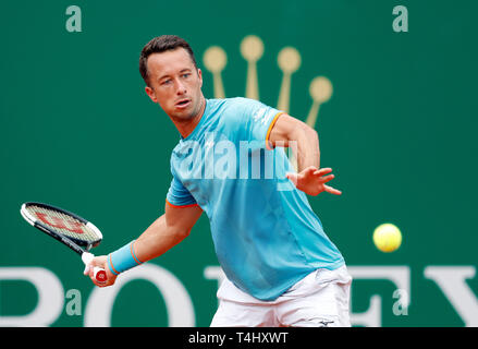 Roquebrune Cap Martin, France. 16th Apr, 2019. Philipp Kohlschreiber of Germany hits a return during the singles second match against Novak Djokovic of Serbia at the Monte-Carlo Rolex Masters tennis tournament in Roquebrune Cap Martin, France, April 16, 2019. Novak Djokovic won 2-1. Credit: Nicolas Marie/Xinhua/Alamy Live News - Stock Photo
