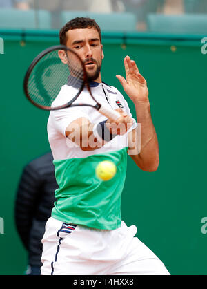 Roquebrune Cap Martin, France. 16th Apr, 2019. Marin Cilic of Croatia hits a return during the singles second match against Guido Pella of Argentina at the Monte-Carlo Rolex Masters tennis tournament in Roquebrune Cap Martin, France, April 16, 2019. Guido Pella won 2-1. Credit: Nicolas Marie/Xinhua/Alamy Live News - Stock Photo