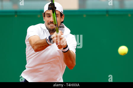 Roquebrune Cap Martin, France. 16th Apr, 2019. Guido Pella of Argentina hits a return during the singles second match against Marin Cilic of Croatia at the Monte-Carlo Rolex Masters tennis tournament in Roquebrune Cap Martin, France, April 16, 2019. Guido Pella won 2-1. Credit: Nicolas Marie/Xinhua/Alamy Live News - Stock Photo