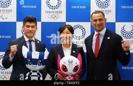 Beijing, Japan. 16th Apr, 2019. Kosei Inoue, head coach of Japan's national judo team, Reika Utsugi, head coach of Japan's national women's softball team, and Koji Murofushi, Tokyo 2020 Sports Director, (from L to R) pose for photos during a press conference announcing the detailed Tokyo 2020 Olympic competition schedule in Tokyo, Japan, on April 16, 2019. Credit: Shen Honghui/Xinhua/Alamy Live News - Stock Photo
