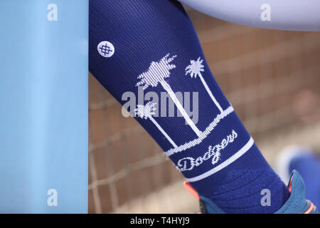 Los Angeles, CA, USA. 16th Apr, 2019. A Dodgers player shows his Dodger socks during the game between the Cincinnati Reds and the Los Angeles Dodgers at Dodger Stadium in Los Angeles, CA. (Photo by Peter Joneleit) Credit: csm/Alamy Live News - Stock Photo