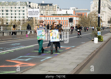London, UK. 17th Apr, 2019. For the Third day Climate change protesters continue to disrupt Waterloo Bridge and Environmental protesters paralyse London's roads by creating human barricades at five landmarks. Extinction Rebellion organisers claim eco-protesters will continue today. On Monday they parked a pink boat in Regent Street to highlight the threat of Global Warming. Credit: Keith Larby/Alamy Live News - Stock Photo