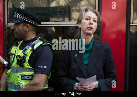 London, UK. 17th April 2019. Dr Gail Bradbrook of Extinction Rebellion addresses journalists after climate change activists from Extinction Rebellion glued themselves to a DLR train at Canary Wharf station on the third day of International Rebellion activities to call on the British government to take urgent action to combat climate change. Credit: Mark Kerrison/Alamy Live News - Stock Photo