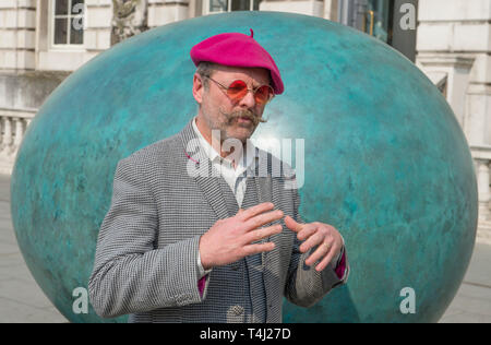 London, UK. 17th April, 2019. A giant bronze egg sculpture, 'Oeuvre', by Gavin Turk (pictured), is unveiled at Somerset House. The bronze egg is intended as a starting point and inspiration for photographers around the world to Collaborate with Gavin on an ambitious public installation for Photo London, titled 'Gavin Turk - Portrait of an Egg'. All that is required to take part is a digital photographic device with which to record their own 'Portrait of an Egg. Credit: Malcolm Park/Alamy Live News. - Stock Photo