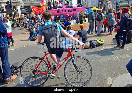 London, UK. 17th April, 2019. Environmental campaign group Extinction Rebellion bring traffic to a standstill in central London for the third day running, camping out in several locations around the city, to demand that the Government take emergency action on the climate and ecological crisis. Oxford Circus. Credit: PjrFoto/Alamy Live News - Stock Photo