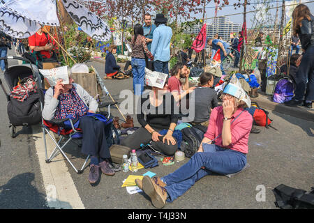 London, UK. 17th Apr, 2019. Protesters in carnival mood as they continue to occupy Waterloo Bridge on Day 3 of the Extinction Rebellion protest  as part of an ongoing protest to force the UK Government to declare a climate crisis emergency in a 2 week campaign Credit: amer ghazzal/Alamy Live News - Stock Photo