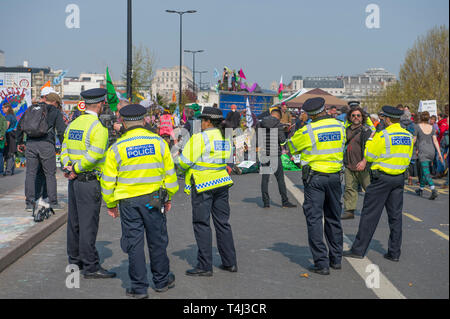 London, UK. 17th April, 2017. Extinction Rebellion Climate Change protesters continue a blockade of Waterloo Bridge to vehicle traffic but with a heavier police presence. Credit: Malcolm Park/Alamy Live News. - Stock Photo