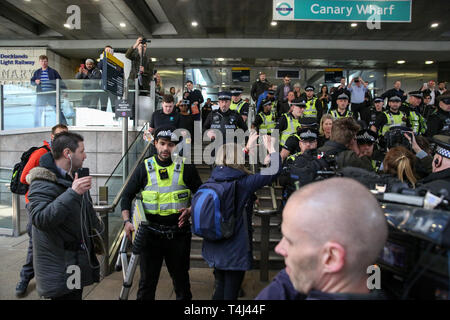 London Underground. UK 17 Apr 2019 - British Transport Police officers and media outside Canary Wharf Docklands Light Railway station as a female environmental activist is arrested by British Transport Police officers on day three of Extinction Rebellion Climate Change protest after glueing herself to the rooftop of a train carriage.   Credit: Dinendra Haria/Alamy Live News - Stock Photo