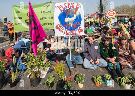 London, UK. 17th April 2019. Two days after Extinction Rebellion closed Waterloo Bridge turning it into a 'Garden Bridge' it remains closed to traffic despite a couple of hundred arrests. Activities continue on the bridge with new protesters arriving. Credit: Peter Marshall/Alamy Live News - Stock Photo