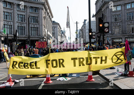 A large banner cutting the road in Oxford Circus during the Extinction Rebellion strike in London.  Extinction Rebellion protesters have blocked five central London landmarks to protest against the government inaction on climate change. - Stock Photo