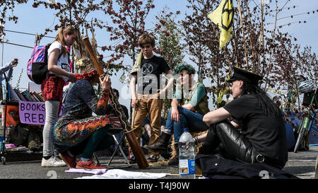 London, UK. 17th Apr, 2019. Protesters speaking on the bridge during the Extinction Rebellion strike in London.Extinction Rebellion protesters have blocked five central London landmarks to protest against the government inaction on climate change. Credit: Brais G. Rouco/SOPA Images/ZUMA Wire/Alamy Live News - Stock Photo
