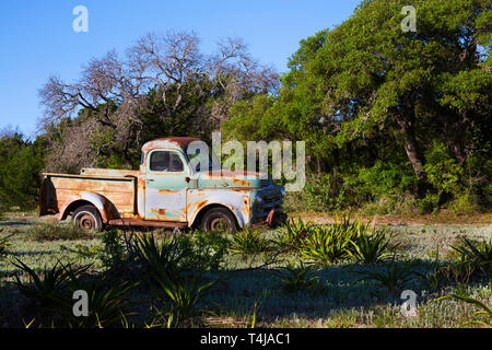 Old Pick Up Truck in an Old Field in Hill Country, Texas - Stock Photo