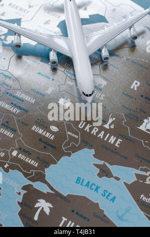 Travel concept. Airplane model on Europe map background. Map of Ukraine. - Stock Photo
