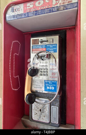 Classic Coin operated public pay telephone with receiver, coin release slot. - Stock Photo