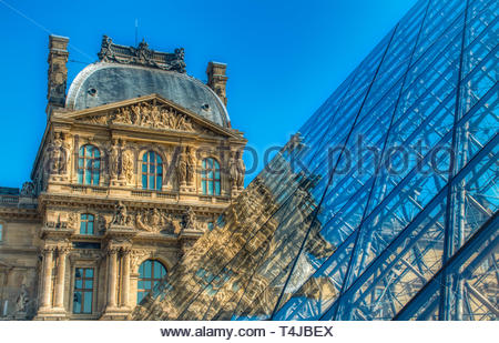 Paris Museum window reflection sky blue glass art sky facade sculpture building castle monument - Stock Photo