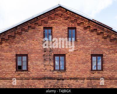 Facade made of bricks. Brick facade of an old hydroelectric power plant. - Stock Photo
