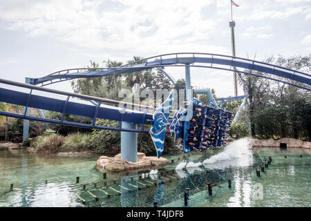 A group of people enjoying their flying roller coaster ride called Manta at Seaworld in Orlando, Florida. - Stock Photo