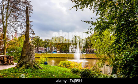 Fountain in the Stadsgracht, the canal around the historic hanseatic city of Zwolle in the Netherlands - Stock Photo