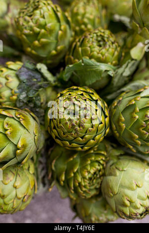Upper view shot of artichokes. Vertical composition. - Stock Photo