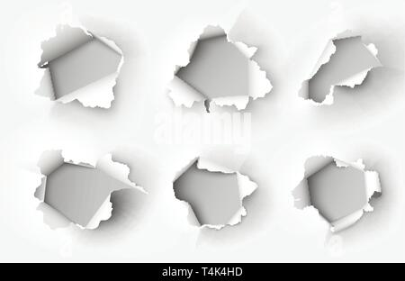 Holes torn in paper on white background - Stock Photo
