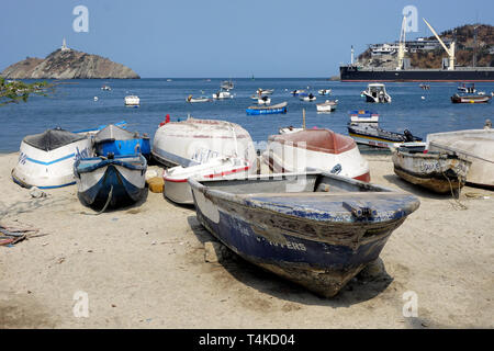 Close Up of Beached Fishing Boats against the Backdrop of a Port and the Open Sea - Stock Photo