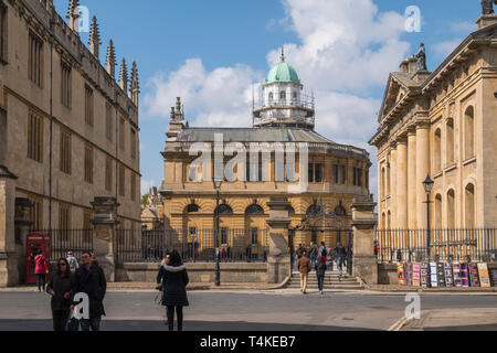View from Catte Street of Sheldonian Theatre with Bodleian Library on left and Clarendon Building on right, all part of University of Oxford, UK - Stock Photo