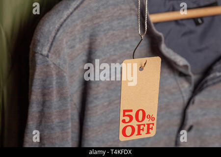 Clothing tag with 50% off on fishing hook - Stock Photo