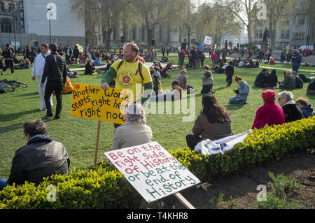 Protestors from Extinction Rebellion with banners congregate on Parliament Square, Westminster for the Extinction Rebellion demonstration - Stock Photo