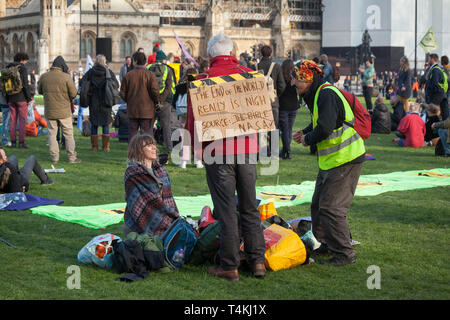 Protestors with banners congregate on Parliament Square, Westminster for the Extinction Rebellion demonstration - Stock Photo