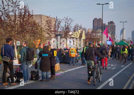 Protestors gather on Waterloo Bridge for the Extinction Rebellion demonstration - Stock Photo