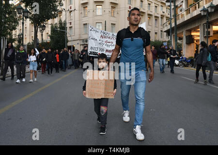 Athens, Greece. 16th Apr 2019. Refugees fearing evictions march with supporters towards the EU offices calling for funding for the EU ESTIA program which provides rental housing and cash assistance in Athens, Greece. Credit: Nicolas Koutsokostas/Alamy Stock Photo. - Stock Photo