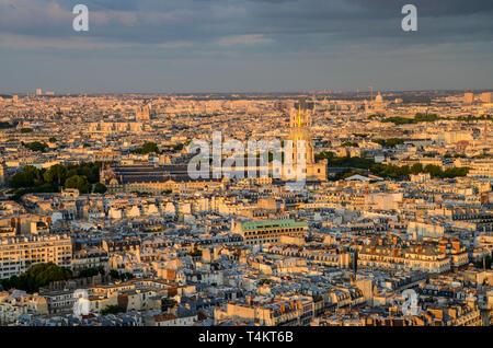 Paris, France skyline at dusk. Notre Dame, The Army Museum Musée de l'Armée, domes, historic buildings. Gold leaf, gilded dome. 7th arrondissement - Stock Photo