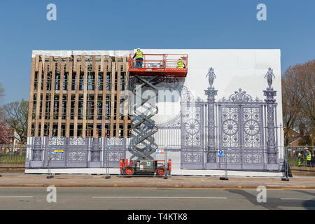 17 April 2019 - Warrington Town Hall Golden Gates have been removed for restoration and a large impression left in their place. Workmen using a Skyjac - Stock Photo