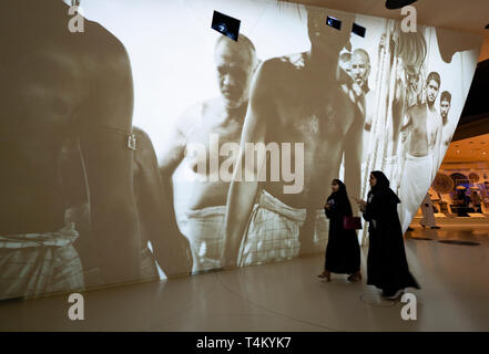 Video installation on Qatari life and culture at the new National Museum of Qatar in Doha , Qatar. Architect Jean Nouvel. - Stock Photo