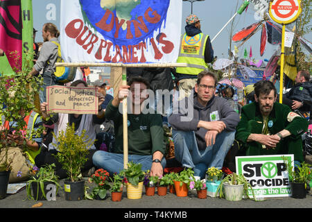 Extinction Rebellion protest in London. Environmental activists block traffic on Waterloo Bridge. - Stock Photo