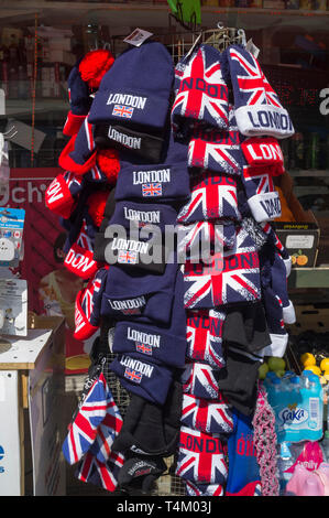 Colourful souvenir hats on sale in London - Stock Photo