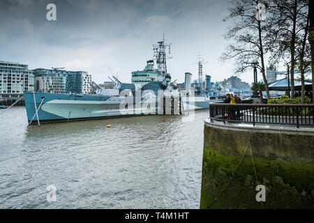 The tourist attraction HMS Belfast moored on the River Thames in London. - Stock Photo