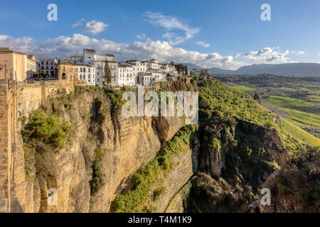 View of Old Town Cityscape and Surrounding Landscape in Ronda, Spain on the Tajo Gorge - Stock Photo